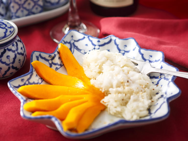 Khao Neeo Mamuang, a Thai dessert of Mango with sticky rice