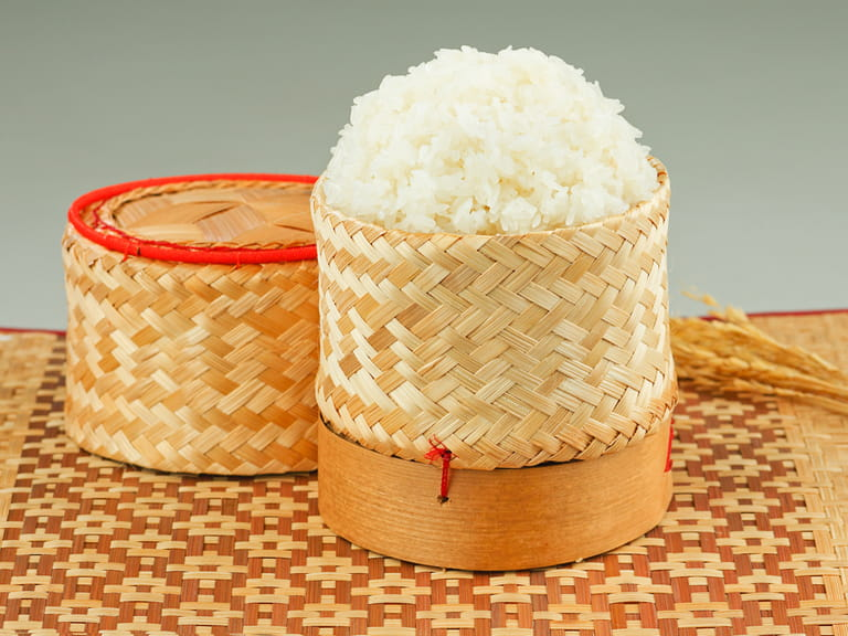 Thai sticky rice in a bamboo wooden style box