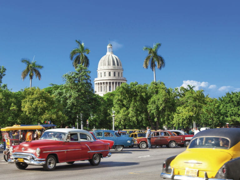 A cuban road with El Capitolio in the background, the former seat of government in Cuba until the Cuban Revolution
