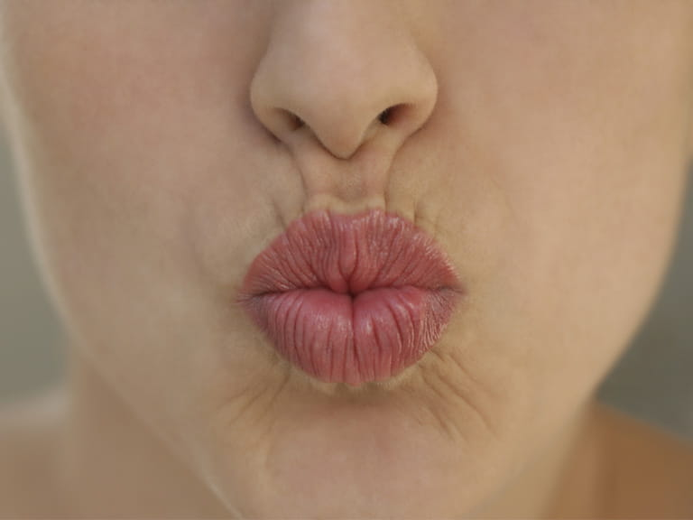 Woman puckered lips