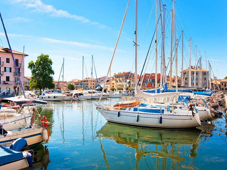 Beautiful scene of boats lying in the harbor of Grado, Friuli-Venezia Giulia, on the Adriatic coast in Italy