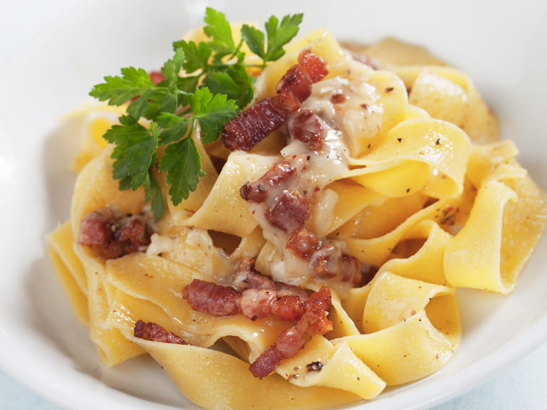 Traditional Italian Pasta Carbonara with egg, pancetta and Parmesan