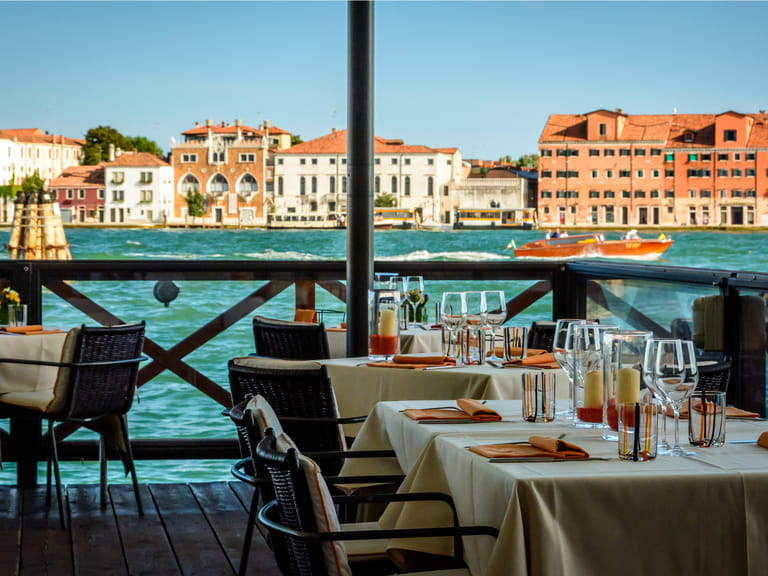 Restaurant and dining tables on Venice canal