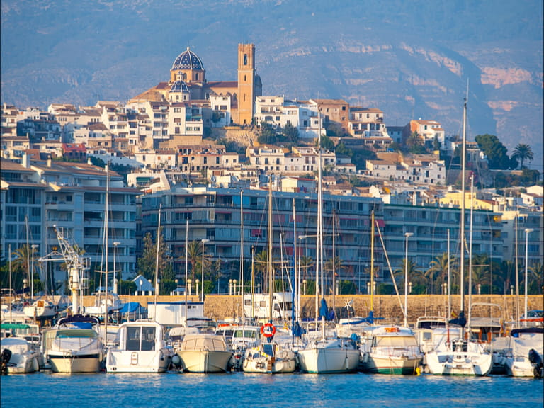 Altea village in alicante with marina boats foreground at Spain Valencian Community