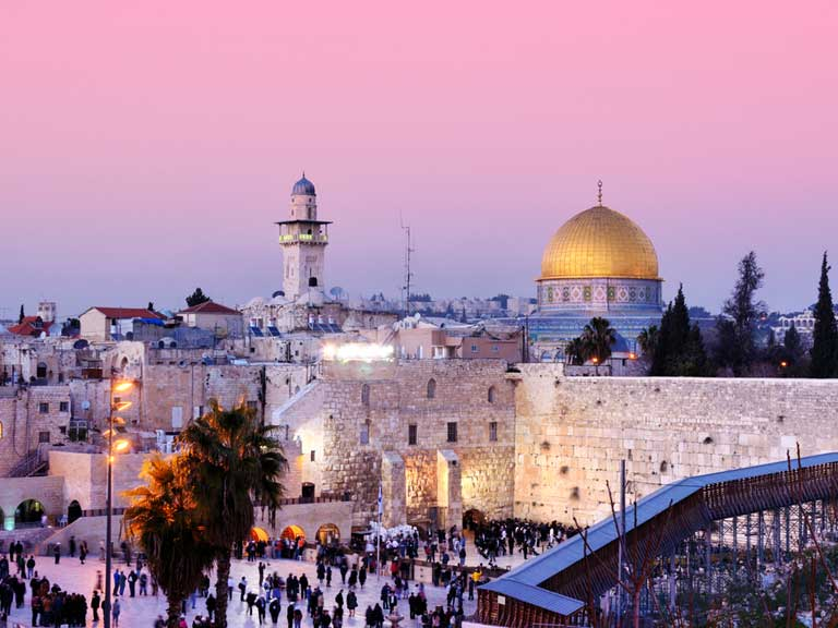 A sunset view of Dome of the Rock and Western Wall in Jerusalem, Israel