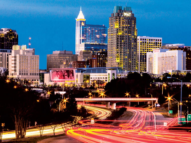 City skyline at night in Raleigh, North Carolina, USA.