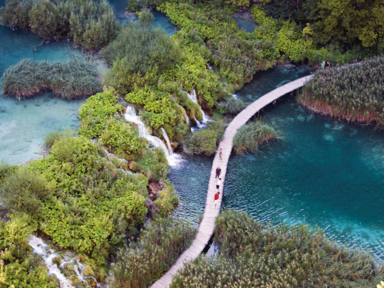 An aerial view of a bridge in Plitvice Lakes National Park, Croatia