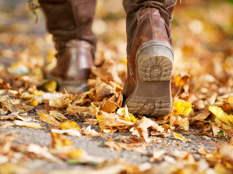 Walking through autumn leaves