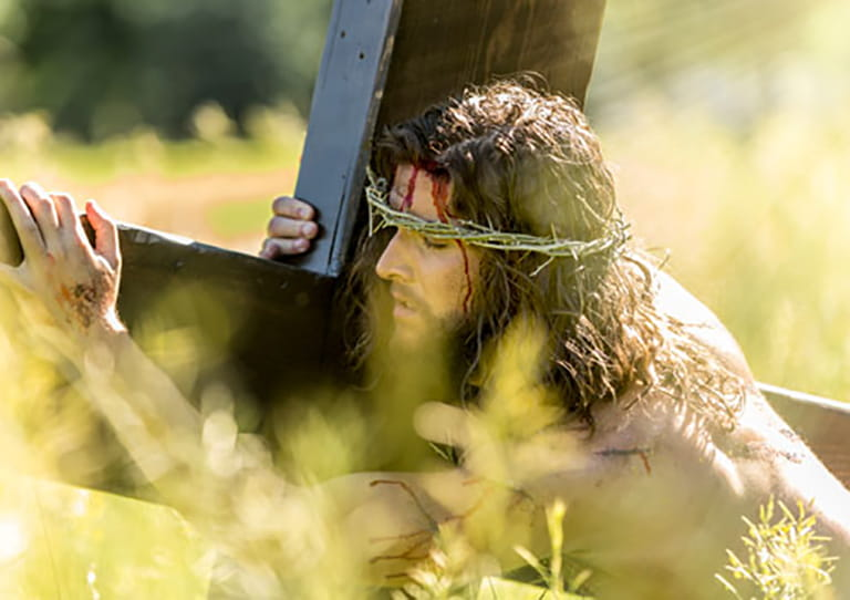 Man carrying the cross in Oberammergau Passion Play