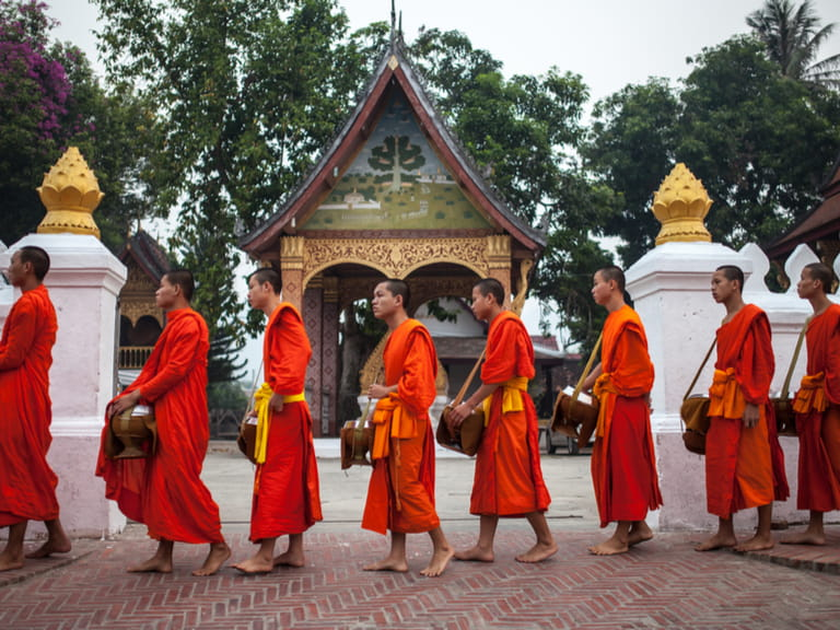 Monks during the early morning alms giving in Luang Prabang, Laos on 10 April 2013  © Catwalk Photos / Shutterstock.com =