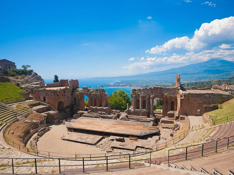 Greek theater in Taormina with the Etna volcano in the back in Sicily, Italy