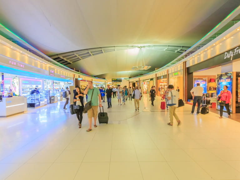 Holidaymakers shopping at Bangkok airport