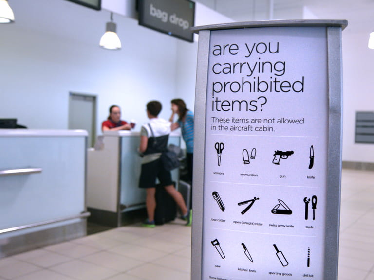 Advice board at an airport showing restricted items