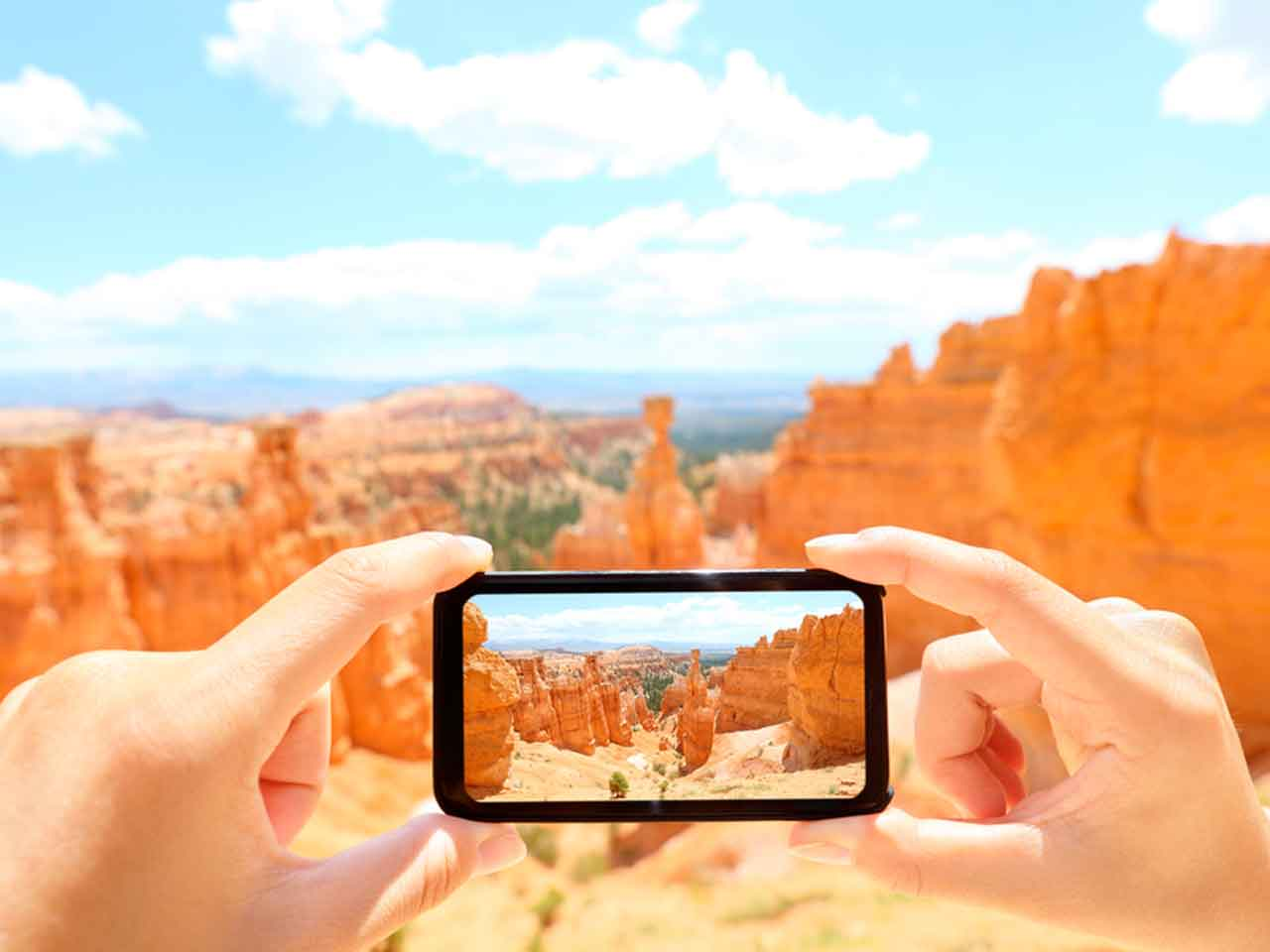Photo app on smart phone taking picture of Grand Canyon
