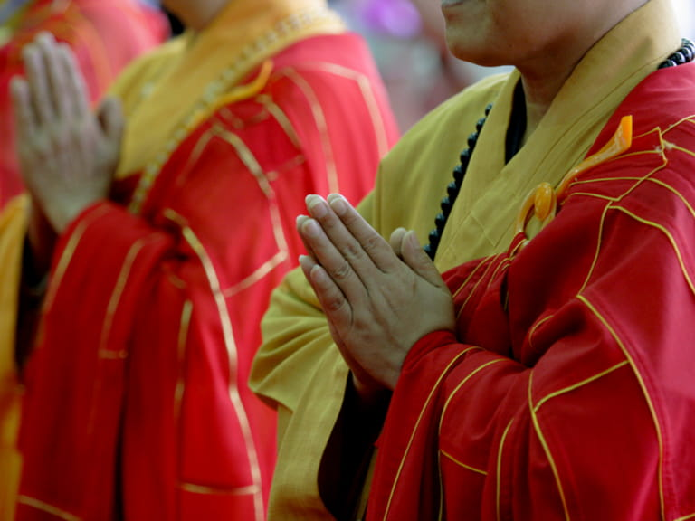 A group of monks pray during ceremony for Buddha birthday.