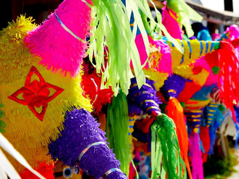 Mexican party pinatas decorated with fringed tissue colorful paper for Cinco de Mayo