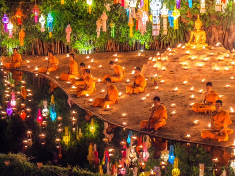 Monks chanting and praying in Loy krathong Festival. Image © 06photo / Shutterstock.com