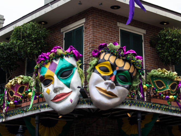 Brightly colored masks adorn a railing in the French Quarter as Mardi Gras approaches in New Orleans