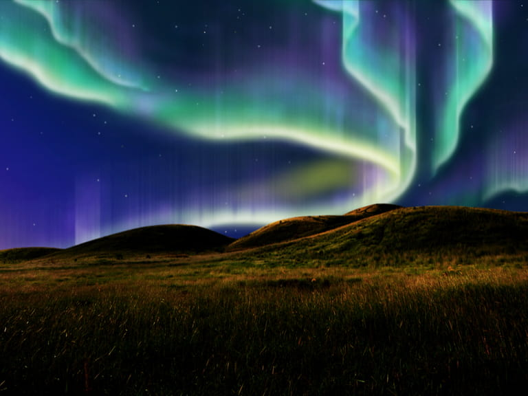 Northern Lights over fields in Norway