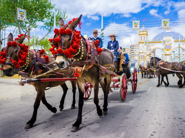 Horses and traditional dress during the Seville Feria
