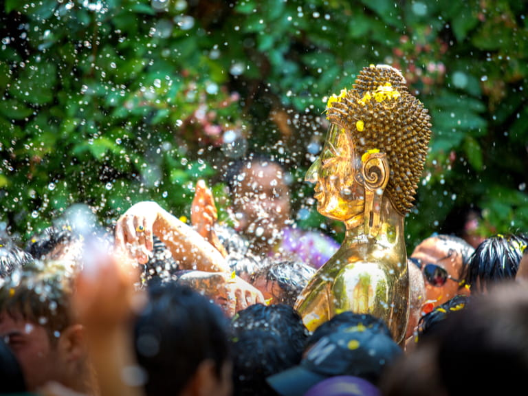 Buddha statue water ceremony in songkran festival, thailand