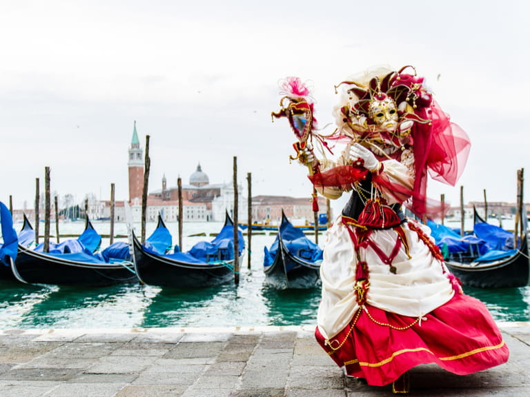 Beautiful mask with gondolas during the carnival in Venice