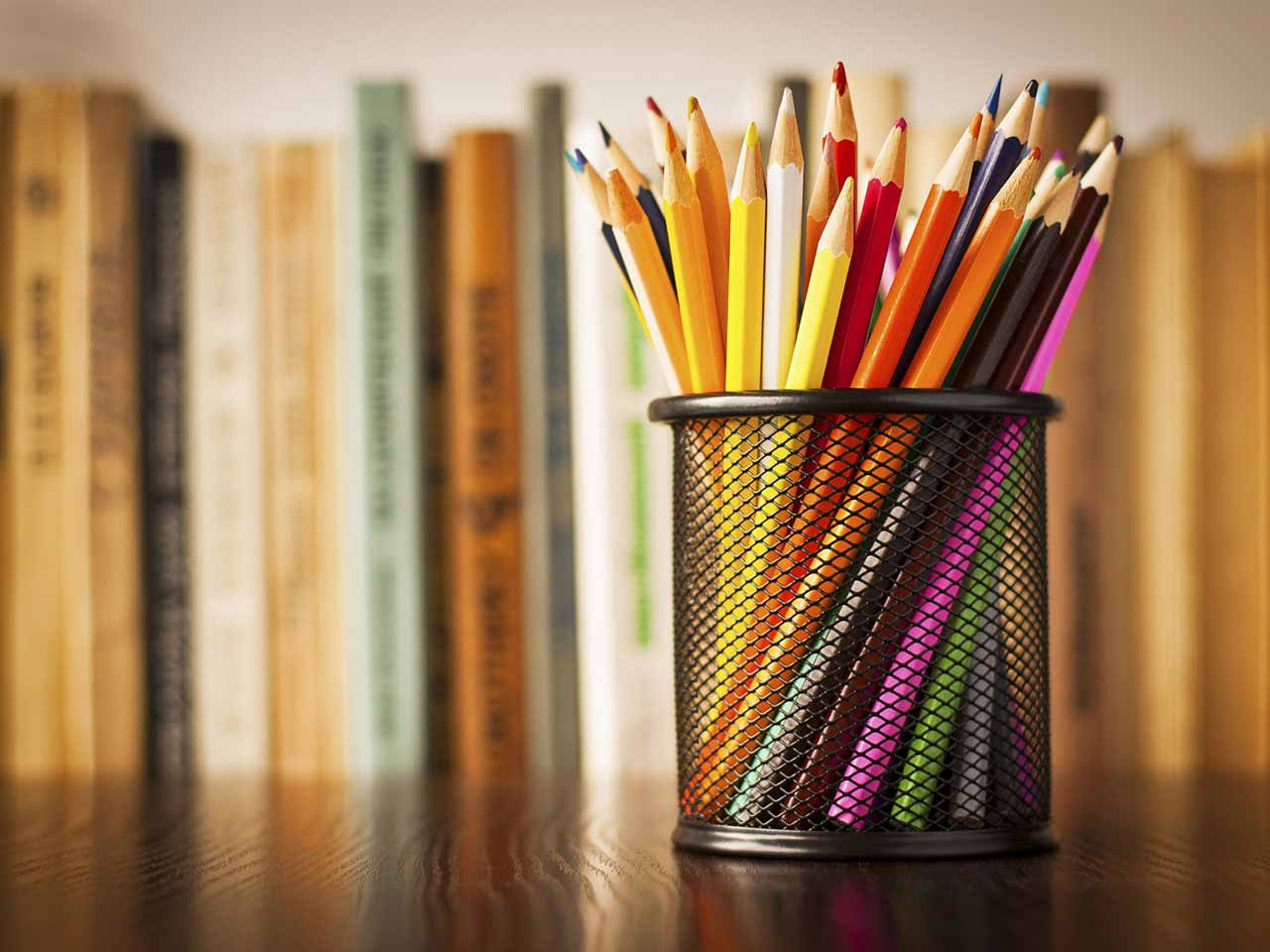 Pencil pot tidy and books on desk