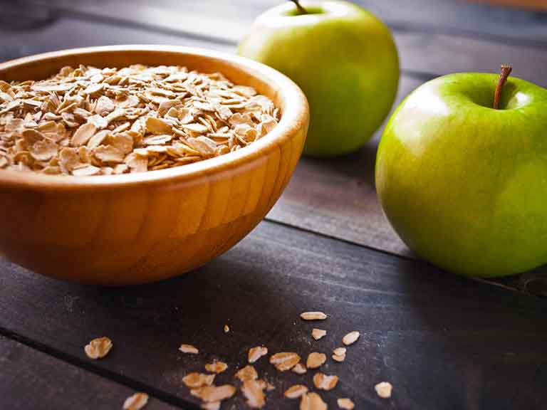Oats and apples are two foods that may be helpful in helping to lower LDL  cholesterol