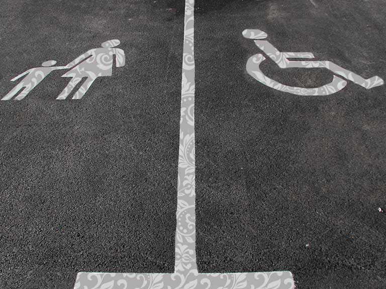 A parent and child car parking space next to a disable car parking space