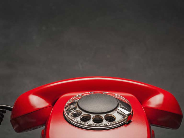 A landline phone with a rotary dial