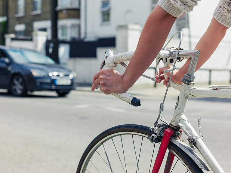 A cyclist navigates a road in the UK