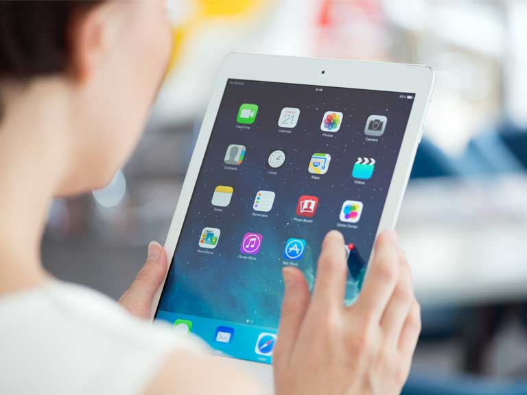 Woman using an iPad tablet