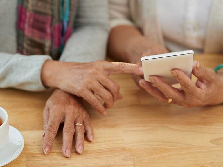 Two older women use these tips to regain control of their online lives
