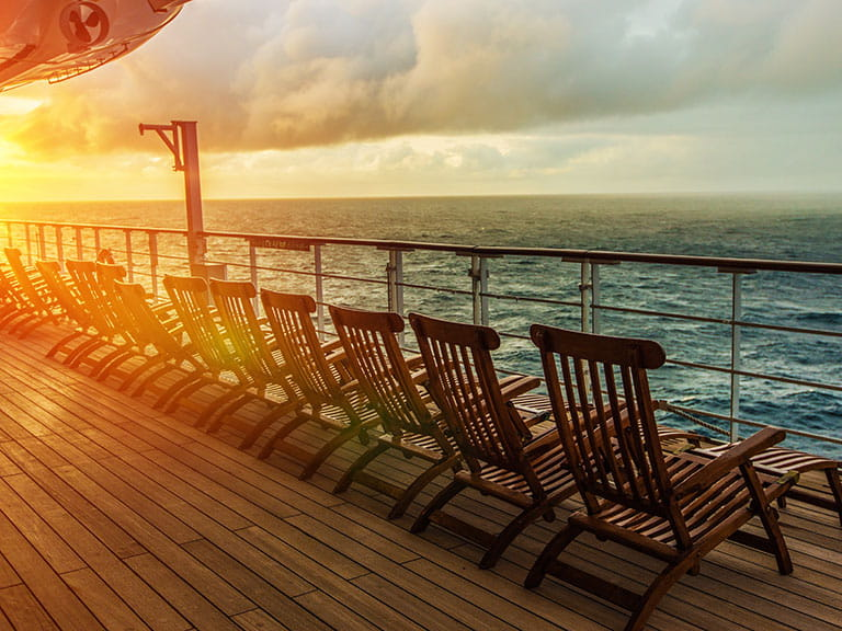 The sun sets over the deck chairs