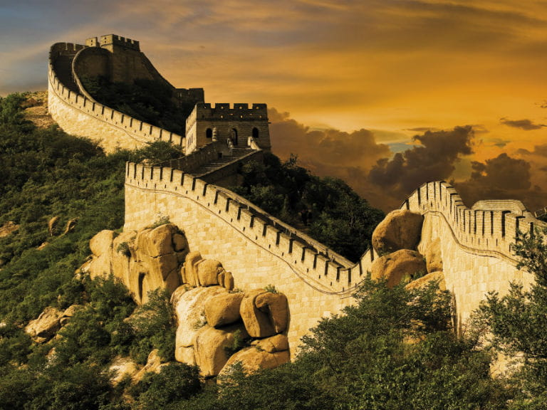 A section of the Great Wall of China at sunset