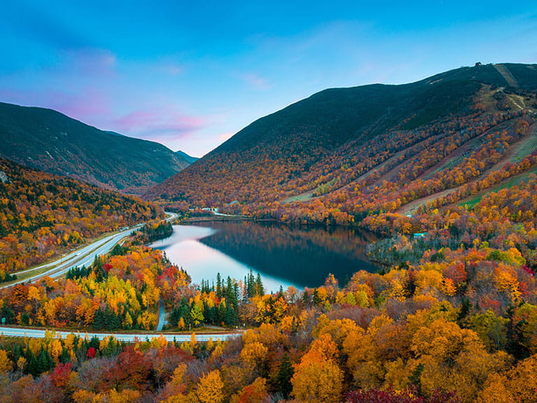 A scenic view of the White Mountains National Forest in New England during fall, or autumn'