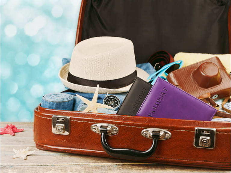 Suitcase with items to pack for a touring holiday