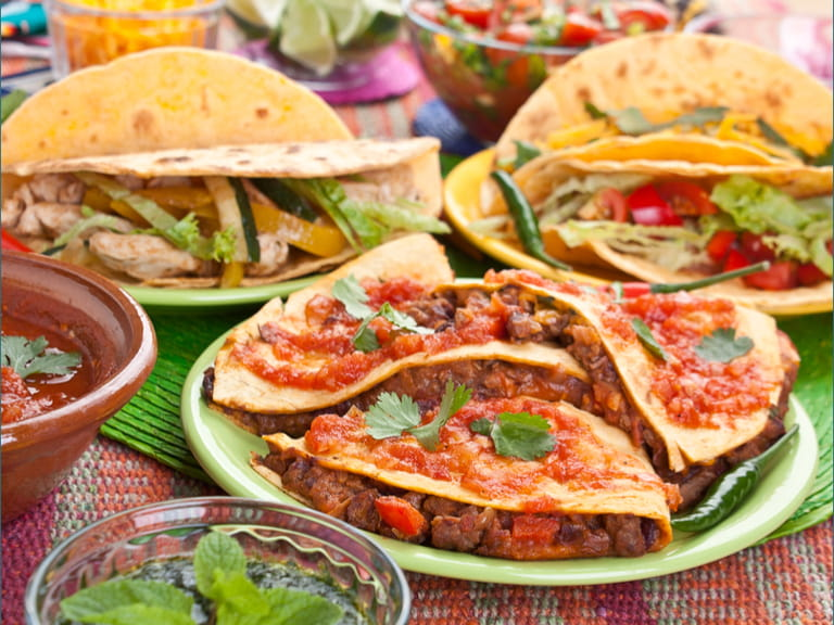 A plate of mixed Mexican food'