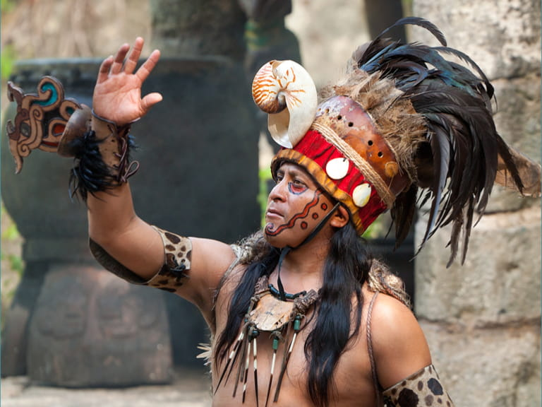Pre-Hispanic Mayan performance called 'Dance of the Owl' in the jungle at ancient Mayan Village © Patryk Kosmider / Shutterstock.com