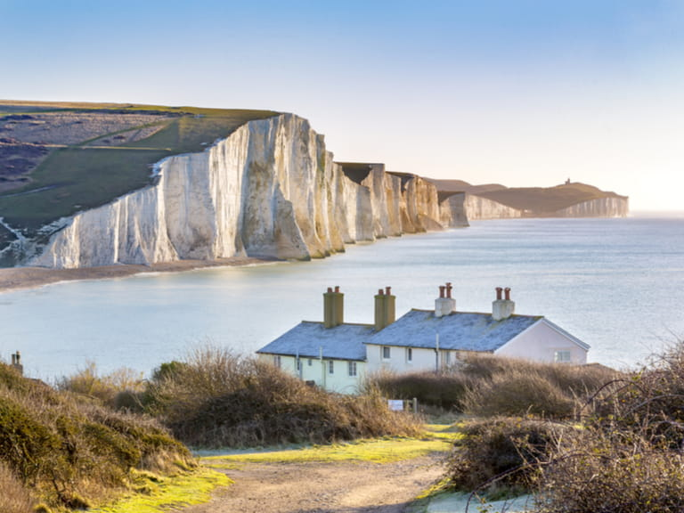 The Coast Guard Cottages & Seven Sisters Chalk Cliffs just outside Eastbourne, Sussex, England, UK.